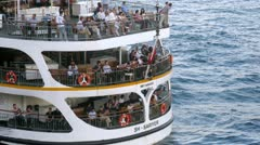 Tourists sit on decks of walking ship, on Karakoy-Kadikoy ferry Stock Footage