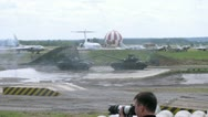 Tanks carry out maneuvers before audience at second forum Stock Footage