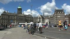 Netherlands Amsterdam dam square walking bikes on steps Stock Footage