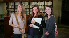 Confident Female Students Smile at Camera in Library Stock Footage