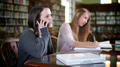 Distracting Student in Library 2683 Stock Footage