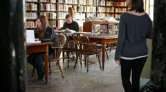 Students in the Library 2692 - stock footage