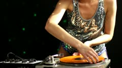Female dj dancing and playing records Stock Footage