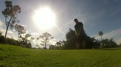 Golf Swing in the Afternoon Sun Stock Footage