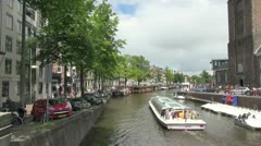 Amsterdam canal boat zoom in Stock Footage