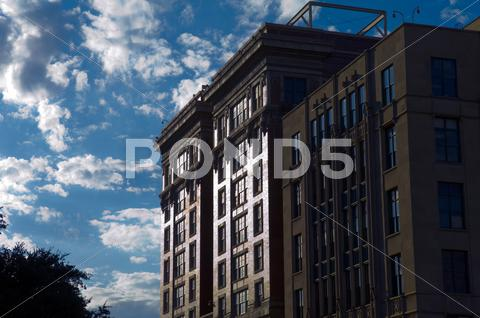 Stock photo of old building reflecting sunlight