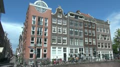 Amsterdam houses in a row by a canal Stock Footage