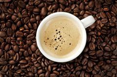 cappucino on coffee beans - stock photo