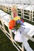 Stock Photo of floral decor on white chair