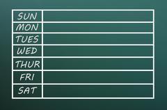 Blank weekday calendar form written with chalk on green chalkboard Stock Photos