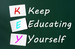 Key acronym -keep educating yourself on a blackboard with sticky notes Stock Photos
