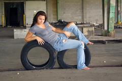 Sexy brunette with tattered jeans (1) Stock Photos