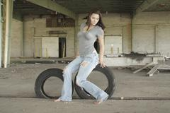 Sexy brunette with tattered jeans (2) Stock Photos