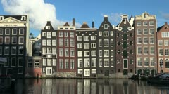 Amsterdam row of houses by water  Stock Footage