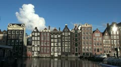 Amsterdam houses by water with cloud Stock Footage