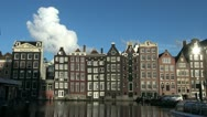 Stock Video Footage of Amsterdam houses by water with cloud