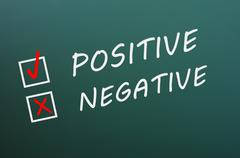 chalk drawing of positive and negative with check boxes - stock photo
