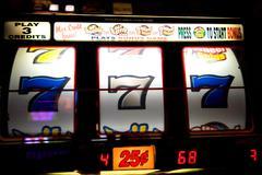 Slot machine with 7's Stock Photos