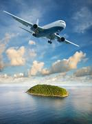 Flight to paradise. summer vacation theme. vertical composition in very high  Stock Photos