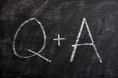 Question and answer symbols on a blackboard Stock Photos