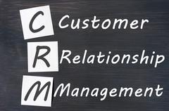 acronym of crm - customer relationship management written on a blackboard - stock photo