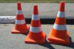 Three orange cone sign Stock Photos