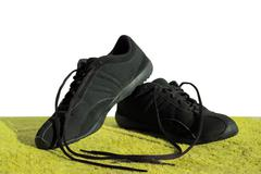 black shoes on a green field - stock photo