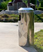 metal trashcan in park - stock photo