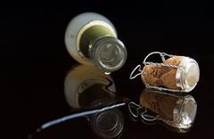 Closeup bottle, drop and cork Stock Photos