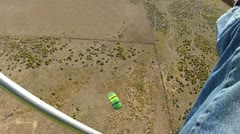 Ultralight parachute flying from above HD 023 Stock Footage