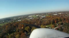 Cessna Landing with fall colors - stock footage