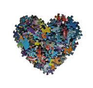 Heart made from the puzzle Stock Photos