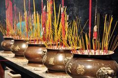 Incense or joss sticks burning in jars Stock Photos