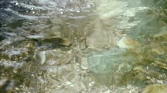 Pebbles,fish & gravel under water,reflection on water,river stream on valley. Stock Footage