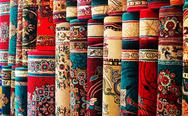 Persian blankets at a market Stock Photos