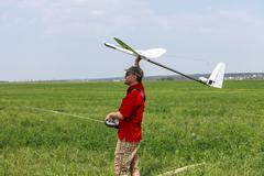 man launches into the sky rc glider - stock photo