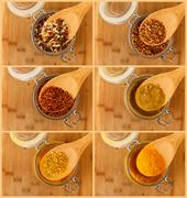 Collage of mixture spice in a wooden spoon Stock Photos