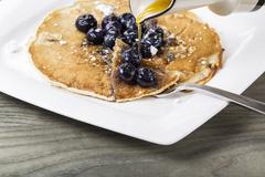 maple syrup with blueberry pancakes - stock photo