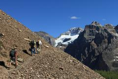 hikers in the canadian rockies - stock photo