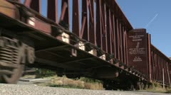 Railway, branch-line railroad freight train low angle, bulkhead and box cars Stock Footage