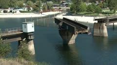 Swing bridge turning, railroad bridge over lake Stock Footage