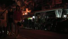 Sidewalk at night in tourist city. Stock Footage