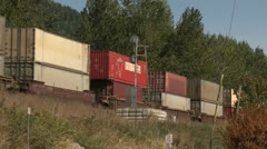 Railway, Container train on raised railway bed Stock Footage