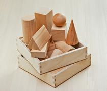 wooden geometric shapes on the table - stock photo
