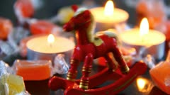 Small wooden horse and candies Stock Footage