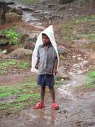 Boy Standing in rain - stock photo