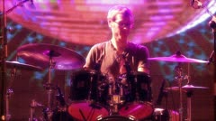 Crazy drummer with a colorful background Stock Footage