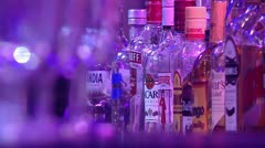 Bottles of alcohol-change focus to glass Stock Footage