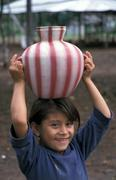 Guatemala girl carrying water camp for returnees Stock Photos