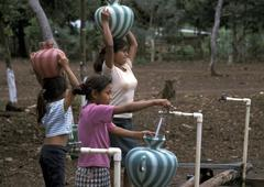 Guatemala collecting water from standpipes santa Stock Photos